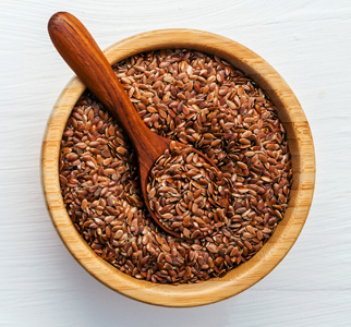 Bowl of flaxseed, with wooden spoon