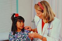 Picture of a female physician talking to a young female patient