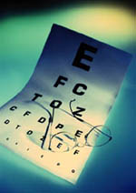 Picture of an eye chart and pair of eyeglasses