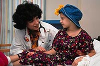 Picture of pediatric oncology patient being comforted by her physician